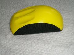Oblong sanding block with finger grip